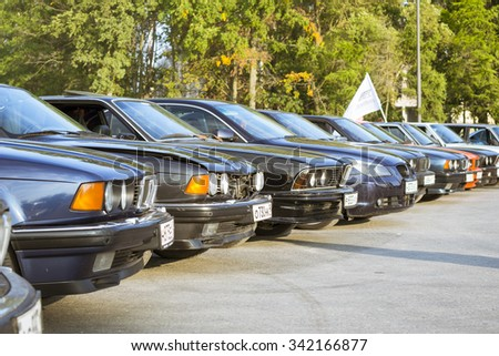 SAINT-PETERSBURG, RUSSIA - AUGUST 3, 2013: Old-cars BMW 5-series and 6-series at the meeting, fans of the Bavarian automaker, Krestovsky island, St. Petersburg - stock photo
