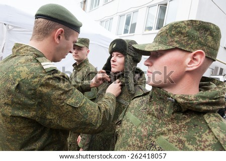Saint Petersburg, Russia  - August 22 2013.  Russian soldiers during a demonstration of a new military uniforms at a garment factory on August 22, 2013 in , Saint Petersburg, Russia.  - stock photo