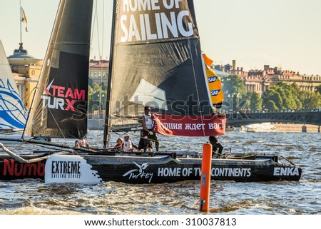 "SAINT-PETERSBURG, RUSSIA - AUGUST 23, 2015: Team Turx (Turkey) with a banner ""Turkey waits for you"" at Extreme Sailing Series Act 6 catamarans race on 20th-23th August 2015 in St. Petersburg, Russia - stock photo"