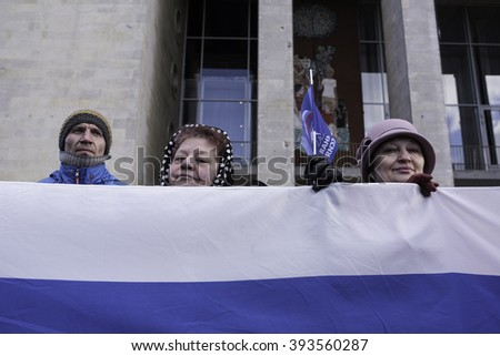 Saint-Petersburg, Russia - March 18, 2016: the rally on the occasion of the second anniversary of the reunion of Crimea to Russia, Participants of the meeting with the national flags of Russia - stock photo