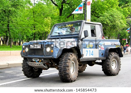 SAINT PETERSBURG, RUSSIA - MAY 25: Oleg Kivkov's off-road vehicle Land Rover Defenfer 90 No.714 competes at the annual Ladoga Trophy Challenge on May 25, 2013 in Saint Petersburg, Russia. - stock photo