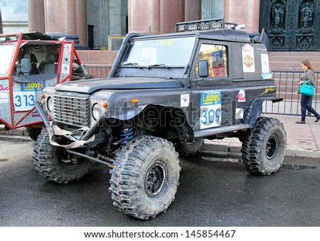 SAINT PETERSBURG, RUSSIA - MAY 25: Viktor Kozlovsky's off-road vehicle Land Rover Defender 90 No.309 competes at the annual Ladoga Trophy Challenge on May 25, 2013 in Saint Petersburg, Russia. - stock photo