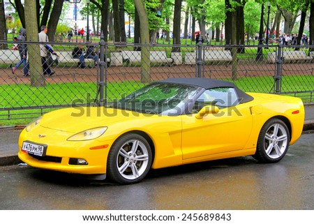 SAINT PETERSBURG, RUSSIA - MAY 26, 2013: Yellow american sportscar Chevrolet Corvette at the city street. - stock photo