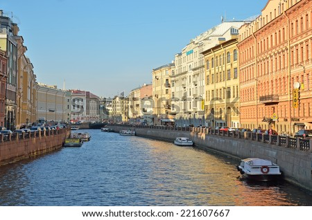 SAINT-PETERSBURG, RUSSIA - SEPTEMBER 20, 2014: Architectural complex of historical buildings of Moika River Embankment. View from the Green Bridge of the Nevsky Prospect. - stock photo
