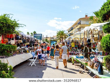 SAINT-RAPHAEL, FRANCE- AUGUST 16: Many tourists on shopping street by coastline of French riviera of Saint-Raphael on August 16, 2015. - stock photo