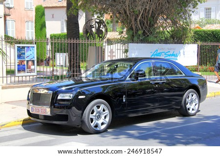 SAINT-TROPEZ, FRANCE - AUGUST 3, 2014: Black british premium class sedan Rolls-Royce Ghost at the city street. - stock photo