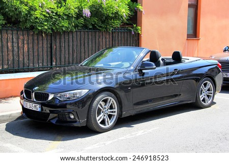 SAINT-TROPEZ, FRANCE - AUGUST 3, 2014: Black convertible sports car BMW F33 4-series at the city street. - stock photo