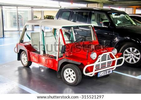 SAINT-TROPEZ, FRANCE - AUGUST 3, 2014: Motor car Austin Mini Moke at the city street. - stock photo