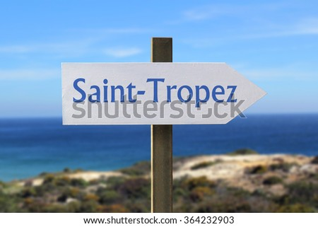 Saint-Tropez sign with seashore in the background - stock photo