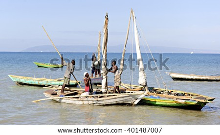SAINTARD, HAITI - MARCH 2, 2016:  Unidentified Haitian fishing men in their boats preparing for a day of fishing off the shore near Saintard, Haiti on March 2, 2016. - stock photo