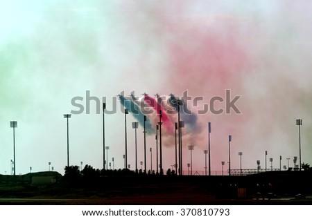 SAKHIR AIRBASE, BAHRAIN - JANUARY 23: Flying display and aerobatic show of Saudi Hawks display team in Bahrain International Airshow at Sakhir Airbase, Bahrain on 23 January, 2016 - stock photo