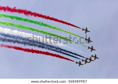 SAKHIR AIRBASE, BAHRAIN - JANUARY 22: Flying display and aerobatic show of The Al Fursan UAE display team in Bahrain International Airshow at Sakhir Airbase, Bahrain on 22 January, 2016 - stock photo