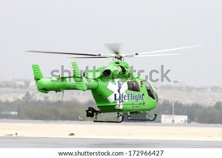 SAKHIR AIRBASE, BAHRAIN - JANUARY 18: Flying display of Life Flight Helicopter in Bahrain International Airshow at Sakhir Airbase, Bahrain on 18 January, 2014 - stock photo