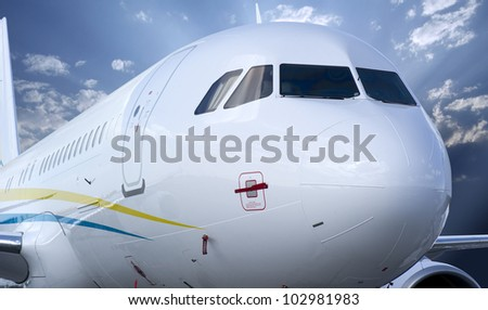 SAKHIR, KINGDOM OF BAHRAIN - JANUARY 21: A 320 parked on the apron, at the Sakhir Airbase during the 2nd Bahrain International Airshow 21 Jan 2012 in Bahrain. - stock photo