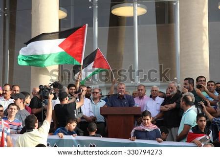 SAKHNIN, ISRAEL- OCTOBER 13: Arab Israeli Muslim Mohammad Barakeh, an Israeli Arab politician, speaks during anti Israel protest demand liberation of Al Aqsa mosque and occupied territories - stock photo