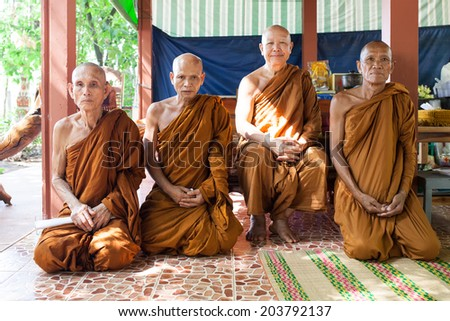 Sakon Nakhon Thailand, on 8 March 2014, the monks Cancer 4 shared bless Buddhist Lent on the merits due to arrive on 11 July 2014. - stock photo