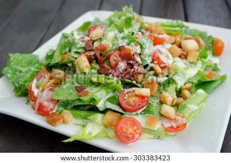 salad caesar on table backgckground - stock photo