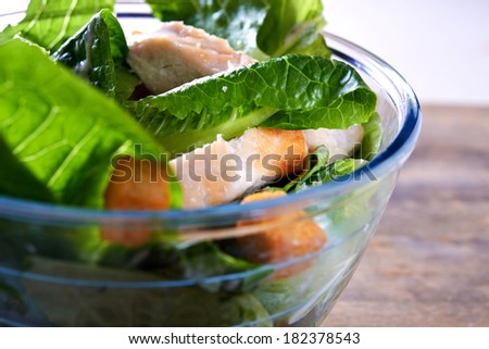 salad ceaser with chicken close up. shallow dof - stock photo