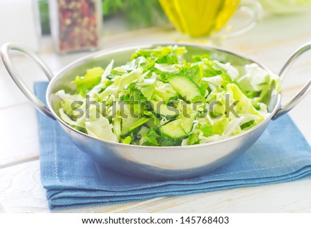 salad from cabbage and cucumber - stock photo