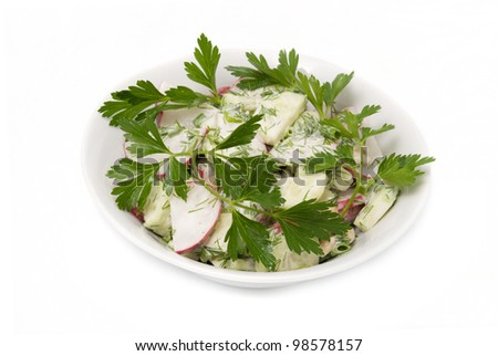 Salad from vegetables is decorated by parsley leaves - stock photo