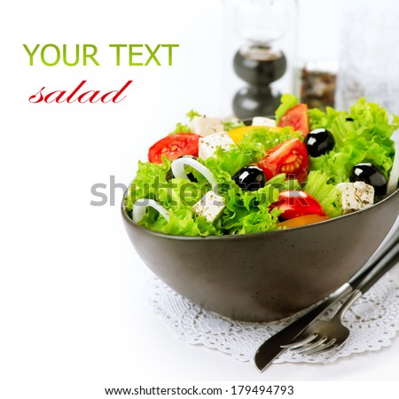 Salad. Greek Salad isolated on a White Background. Mediterranean Salad with Feta Cheese, Tomatoes and Olives. Healthy fresh vegetarian food - stock photo