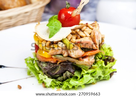 salad greens and vegetables on a plate in a restaurant - stock photo