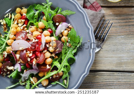 Salad in a plate on the boards, food - stock photo