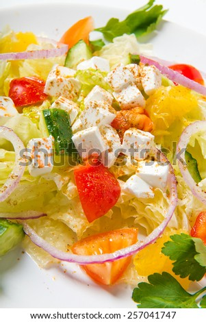 salad in plate on white background - stock photo