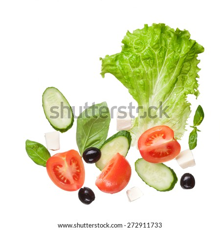 salad isolated in white - red tomatoes, pepper, cheese, basil, cucumber and olives, top view - stock photo