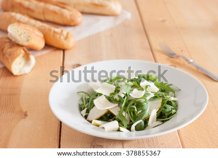 salad of arugula, pears, fennel and parmesan cheese - stock photo