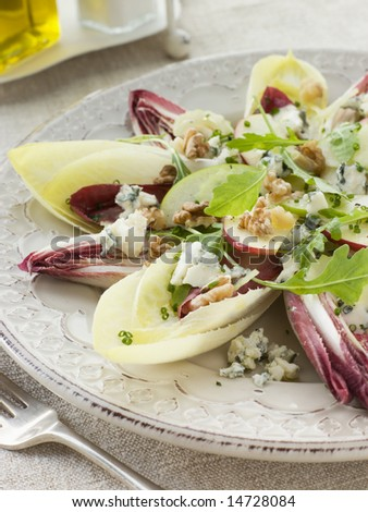 Salad of Chicory Walnuts and Apple with Roquefort Vinaigrette - stock photo