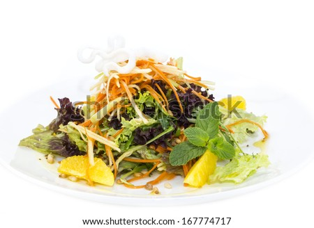 salad of fruit and vegetables on a white background in the restaurant - stock photo