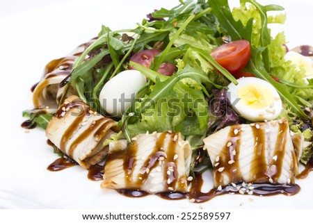 salad of green vegetables and meat, fish eel restaurant - stock photo