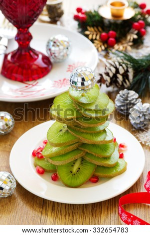 Salad of kiwi in the shape of a Christmas tree. - stock photo