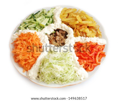 Salad of meat potatoes cabbage carrots cucumber pepper - stock photo