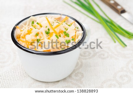 salad of pickled cabbage with carrots and green onions in a cup horizontal - stock photo