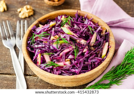 salad of red cabbage, apples and walnuts - stock photo