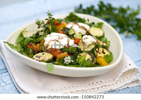 Salad of roast zucchini and goat cheese - stock photo