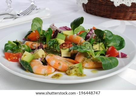 Salad of watercress, cherry tomato and avocado with prawns - stock photo