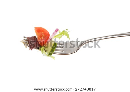 Salad on a fork isolated against white - stock photo