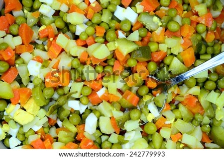 Salad preparation background with cucumber, egg, potato,carrot and green peas - stock photo