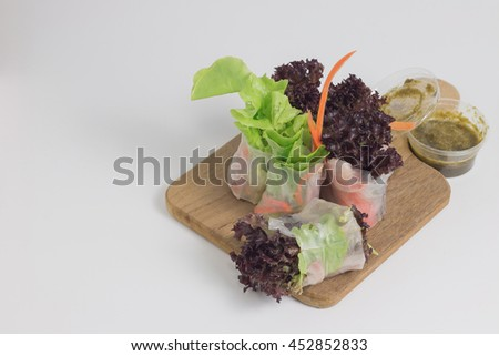 Salad roll vegetables with salad dressing seafood on white background. Copy space for write text. Healthy salad. - stock photo