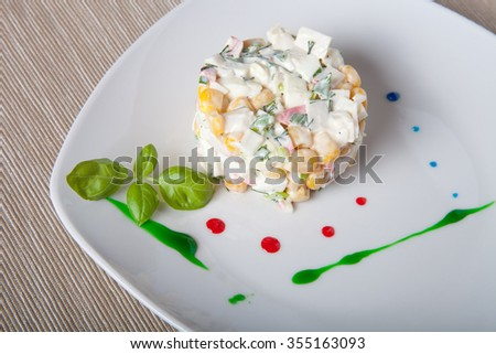Salad serving by strokes of different sauces. - stock photo