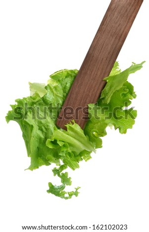 salad tongs green leaf lettuce white background - stock photo