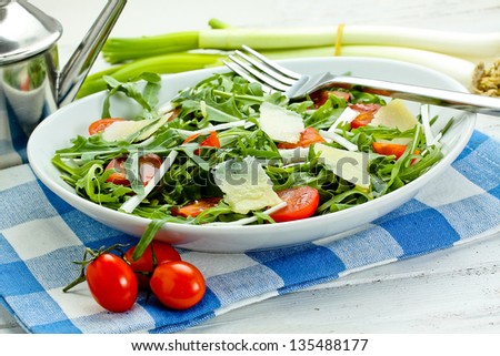 salad with arugula, cherry tomatoes, parmesan and shallot - stock photo