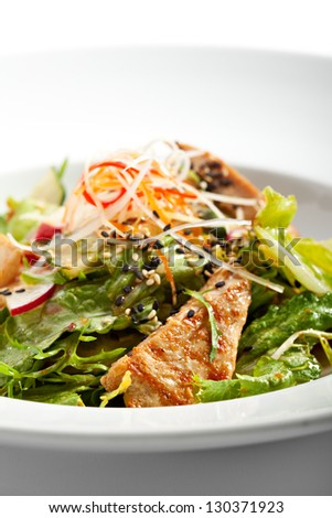 Salad with BBQ Chicken Fillet - stock photo
