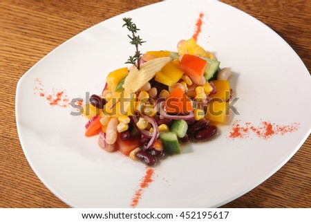 Salad with beans and corn on plate - stock photo
