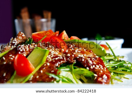 Salad with beef. Tasty and nutritious meat food. Colorfully decorated - stock photo