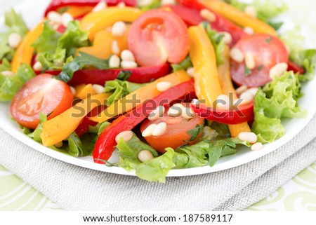 Salad with bell peppers, cherry tomatoes, cashew nuts and greens. Horizontal photo. - stock photo