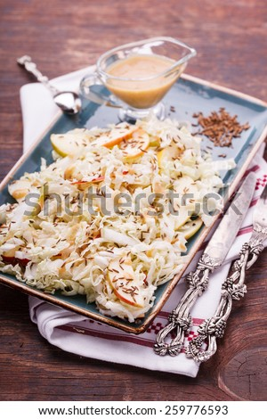 Salad with cabbage with Apple and caraway flavored sauce. - stock photo